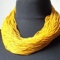 Tamba-Gürtel - Kette der Baule, Elfenbeinküste aus ca. 100 Strängen gelber seed beads, Handelsperlen ursprünglich aus Böhmen