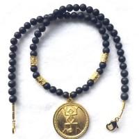 Vergoldeter Anhänger der Tairona Kultur, Columbien, Onyxkugeln und vergoldete Silberteile